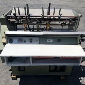 Hunkeler VEA 520 end sheet tipper and inserter